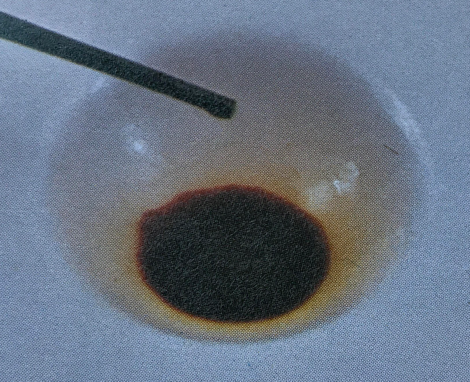 A depression filled with a deep brown liquid.